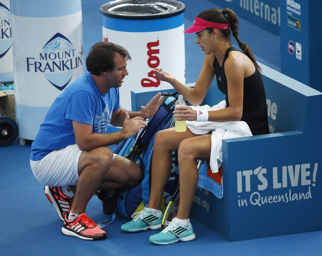 Ana Ivanovic of Serbia speaks with her coach Dejan Petrovich between games against Varvara Lepchenko of the U.S. during their women's singles semi final match at the Brisbane International tennis tournament January 9, 2015. (Photo by Jason Reed/Reuters)