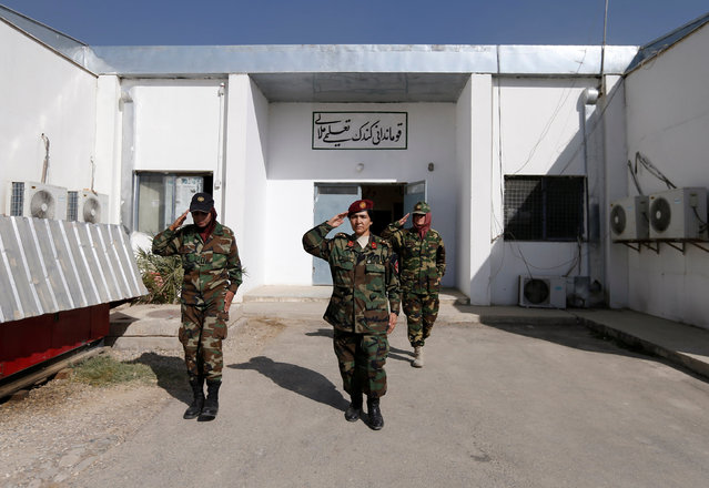 Commander for female Afghan soldiers Lieutenant Colonel Cobra Tanha, 45, leaves her office at the Kabul Military Training Centre (KMTC) in Kabul, Afghanistan October 23, 2016. (Photo by Mohammad Ismail/Reuters).