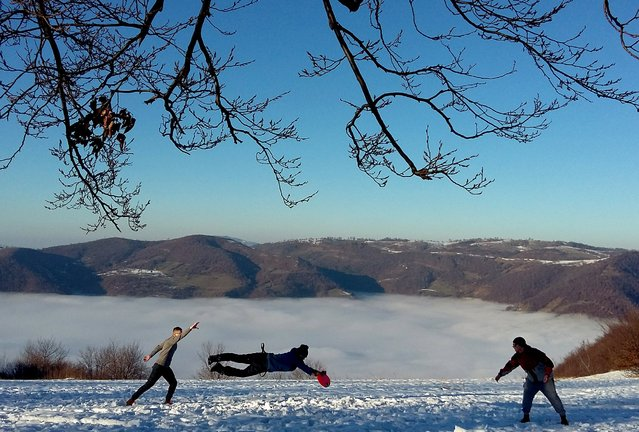 People play Frisbee on the Smetovi mountain range near Zenica, Bosnia and Herzegovina, December 6, 2015. (Photo by Dado Ruvic/Reuters)