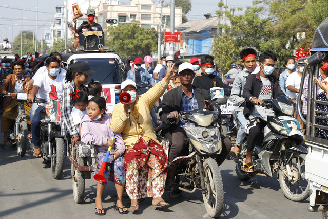 Anti-coup protesters hold a rally in Mandalay, Myanmar, Saturday, February 13, 2021. (Photo by AP Photo/Stringer)