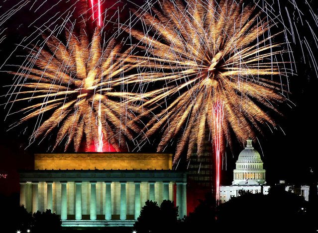 Fireworks light up the sky over the Lincoln Memorial, Washington Monument, and the U.S. Capitol, on July 4, 2013. (Photo by Mark Wilson/Getty Images)