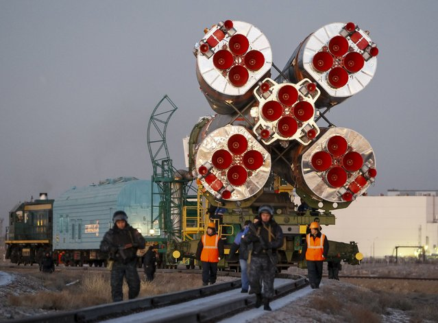 The Soyuz TMA-19M is transported from an assembling hangar to its launchpad at the Baikonur cosmodrome, Kazakhstan, December 13, 2015. (Photo by Shamil Zhumatov/Reuters)