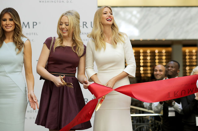 "(L-R) Melania Trump, wife of Republican presidential nominee Donald Trump, and his daughters Tiffany Trump and Ivanka Trump cut the ribbon at the new Trump International Hotel October 26, 2016 in Washington, DC. The hotel, built inside the historic Old Post Office, has 263 luxry rooms, including the 6,300-square-foot ""Trump Townhouse"" at $100,000 a night, with a five-night minimum. The Trump Organization was granted a 60-year lease to the historic building by the federal government before the billionaire New York real estate mogul announced his intent to run for president. (Photo by Chip Somodevilla/Getty Images)"