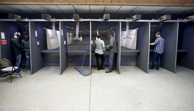 Several shooters target practice with guns at the Ringmasters of Utah gun range, in Springville, Utah on December 18, 2015. (Photo by George Frey/Reuters)
