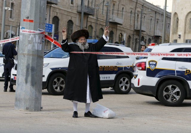 An Israeli man reacts near the scene where a Palestinian was shot dead after he tried to stab an officer, according to a police spokesperson, near Jerusalem's walled Old City December 26, 2015. (Photo by Ammar Awad/Reuters)