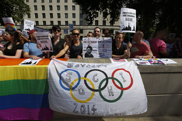 "Activists participate at a protest against Russia's new law on gays, in central London, Saturday, August 10, 2013. Hundreds of protesters, called for the Winter 2014 Olympic Games to be taken away from Sochi, Russia, because of a new Russian law that bans ""propaganda of nontraditional sexual relations"" and imposes fines on those holding gay pride rallies. (Photo by Lefteris Pitarakis/AP Photo)"