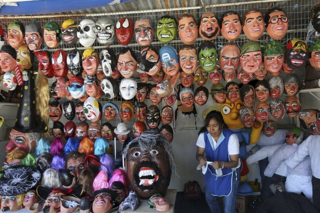 Masks are seen at a stall in preparation for New Year's eve in Quito December 30, 2015. (Photo by Guillermo Granja/Reuters)