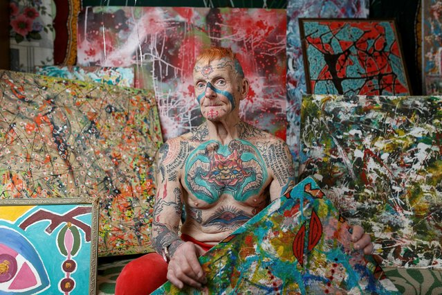 Pensioner Vladimir Sedakov, nicknamed Spartak, poses for a picture at home in Yekaterinburg, Russia March 28, 2021. The active lifestyle of 74-year-old Vladimir Sedakov, who is on his way to cover himself in tattoos top to toe, is quite different from that of a typical pensioner – he creates poetry and paintings, wears incredibly crafted costumes and owns a pet goat called Marusya. (Photo by Alexei Kolchin/Reuters)