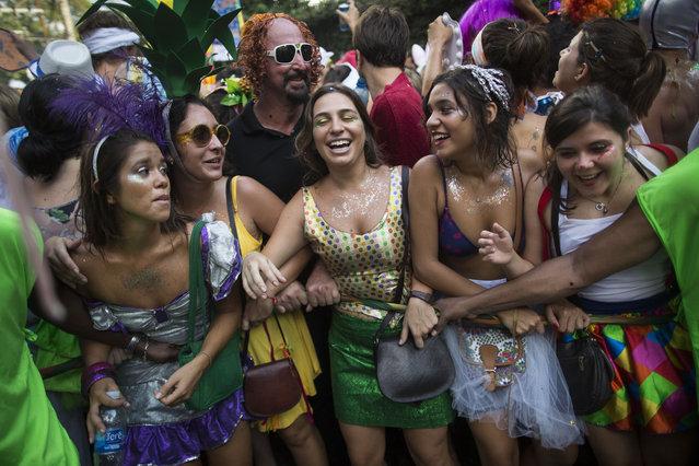 "Revelers pack the streets of Santa Teresa during the ""Ceu na Terra"", or Heaven on earth, carnival parade in Rio de Janeiro, Brazil, Saturday, February 14, 2015. (Photo by Felipe Dana/AP Photo)"