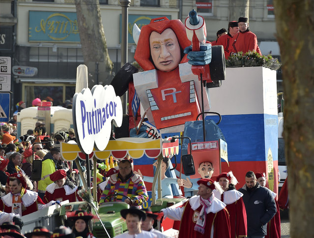 A carnival float depicts Russia's president Putin as a robot out of control named Putinator, , during the traditional carnival parade in Cologne, western Germany, Monday, February 16, 2015. (Photo by Martin Meissner/AP Photo)