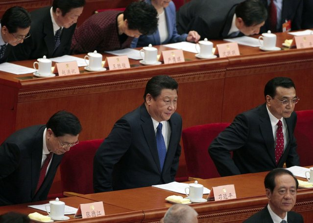 China's President Xi Jinping (C), Premier Li Keqiang (R) and Chairman of the Standing Committee of the National People's Congress (NPC) Zhang Dejiang (L) sit during the opening session of the Chinese People's Political Consultative Conference (CPPCC) at the Great Hall of the People in Beijing, March 3, 2015. REUTERS/Barry Huang