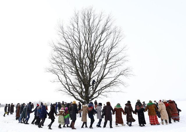 Villagers take part in Kolyada holiday celebrations in the village of Martsiyanauka, Belarus, January 21, 2016. Local residents took part in the celebrations to mark the end of a pagan winter holiday Kolyada, which over the centuries has merged with Orthodox Christmas celebrations. (Photo by Vasily Fedosenko/Reuters)