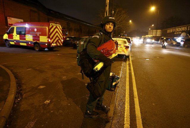 A paramedic in protective gear leaves Winson Green prison, run by security firm G4S, after a serious disturbance involving some 300 inmates broke out, in Birmingham, Britain, December 16, 2016. (Photo by Peter Nicholls/Reuters)