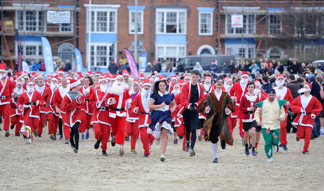 Chase the Pudding, a 5km race along Weymouth beach with runners dressed as Santa, took place on Sunday to raise money for a local charity, the Will Mackaness Trust in Dorset, UK on December 16, 2018. (Photo by Finbarr Webster/Rex Features/Shutterstock)