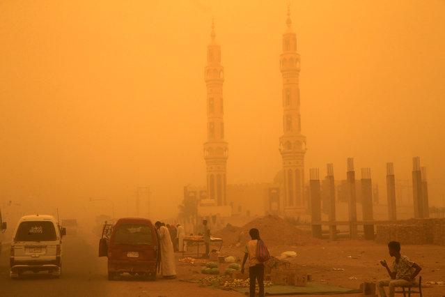 Venders display goods during a sandstorm in Khartoum, Sudan, March 29, 2018. (Photo by Mohamed Nureldin Abdallah/Reuters)