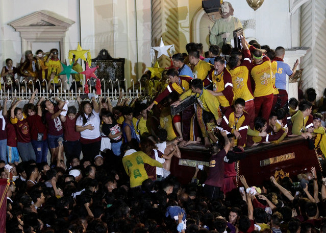 Devotees gather outside Quiapo church as an image of Black Nazarene arrives after the annual procession in Manila, January 10, 2017. (Photo by Czar Dancel/Reuters)