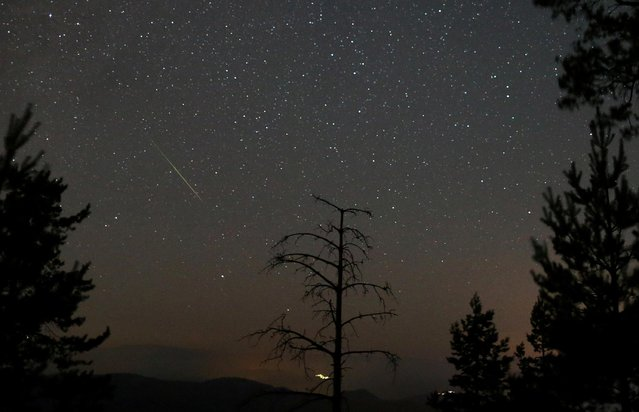 A meteor dashes above Tvrtkovac mountain during the Perseid meteor shower seen from Zenica, Bosnia and Herzegovina, August 8, 2021. (Photo by Dado Ruvic/Reuters)
