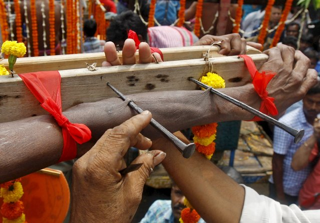 The arm of a devotee is pierced with nails during the annual Shiva Gajan religious festival in Batanal village, east of Kolkata, April 14, 2015. (Photo by Rupak De Chowdhuri/Reuters)