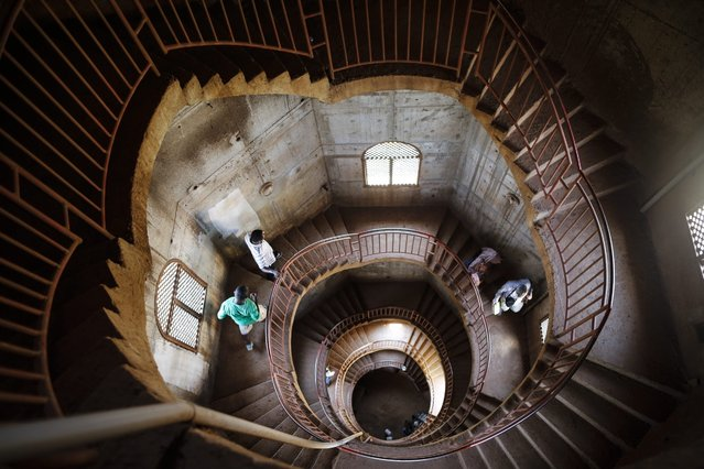 A photograph made available on 23 February 2016 shows visitors walking down the staircase of the minaret of the Uganda National Mosque, formerly known as  Gaddafi National Mosque, in Kampala, Uganda, 17 February 2016. (Photo by Dai Kurokawa/EPA)