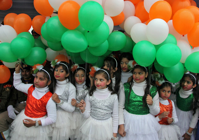Schoolgirls holding tri-coloured balloons take part in the Republic Day celebrations in Chandigarh, India, January 26, 2017. (Photo by Ajay Verma/Reuters)