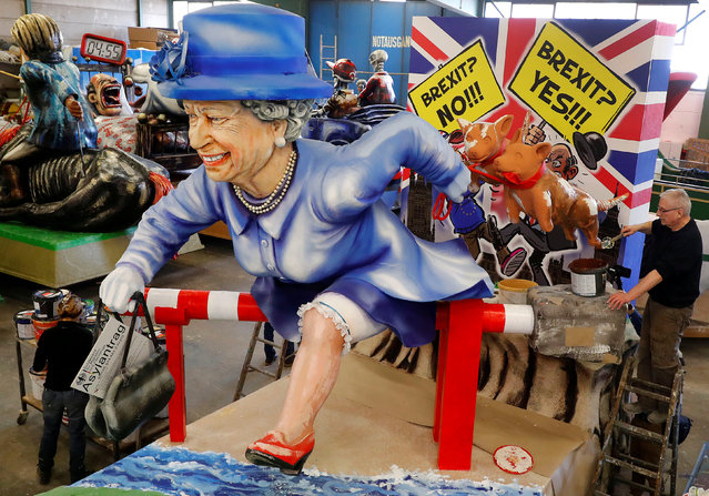 A paper mache figure depicting Queen Elizabeth running for asylum towards the EU is seen during the presentation of the floats for the upcoming Rose Monday parade in Mainz, Germany, February 26, 2019. (Photo by Kai Pfaffenbach/Reuters)