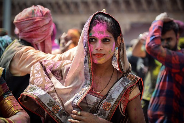 An Indian Hindu devotee celebrates Holi, the spring festival of colours, during a traditional gathering at a temple in Nandgaon village in Uttar Pradesh state on March 16, 2019. Holi, the popular Hindu spring festival of colours is observed in India at the end of the winter season on the last full moon of the lunar month. (Photo by Noemi Cassanelli/AFP Photo)