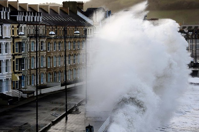 Waves crash up against the seawall at Aberystwyth in Aberystwyth, Wales, on February 2, 2014. High tides, combined with gale force winds and heavy rain, are expected to cause flooding in parts of the United Kingdom. (Photo by Christopher Furlong/Getty Images)
