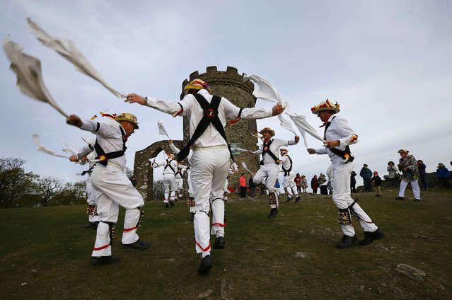 Leicester Morrismen dance during May Day celebrations at Bradgate Park in Newtown Linford, Britain May 1, 2015. The May Day Morris celebration is a traditional rite thought to be connected to changing seasons and fertility. (Photo by Darren Staples/Reuters)