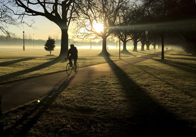 In this June, 26, 2017, file photo, a cyclist makes his way through a mist covered Hagley Park in central Christchurch, New Zealand. Despite its tranquility and beauty, New Zealand city of Christchurch is painfully familiar with trauma and will need to use that experience to recover from terrorist attack. (Photo by Mark Baker/AP Photo)