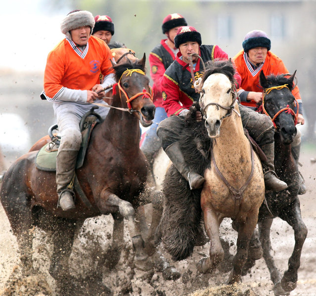 Kyrgyz horsemen participate in the traditional Central Asian sport of Kok-boru (goat dragging), a competition held as part of the Navruz celebrations in Bishkek, Kyrgyzstan, 18 March 2016. Kok-boru is a game where players grab a goat carcass from the ground while riding their horses and try to score by placing it in their opponent's goal. Navruz, also called Nowruz, marks the first day of spring and is celebrated on the day of the astronomical vernal equinox, which usually occurs on 21 March or the previous or following days depending on where it is observed. (Photo by Igor Kovalenko/EPA)