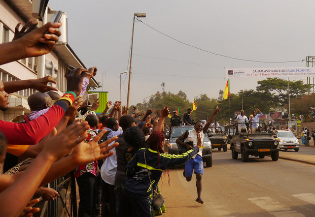 Fans cheer as Cameroon soccer players celebrate with the trophy in a parade held in Yaounde, Cameroon February 8, 2017, after beating Egypt to win the African Cup of Nations. (Photo by Joel Kouam/Reuters)