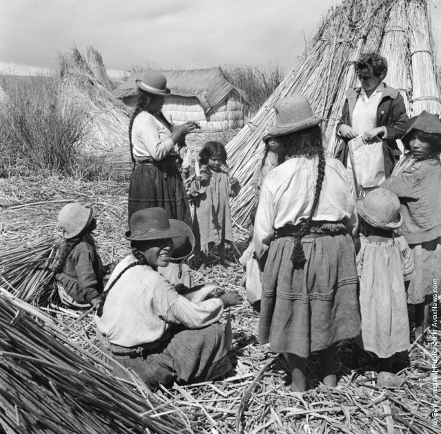 Families of native Uros indians live on small islands fashioned from reeds on Lake Titicaca, in Peru, 1955