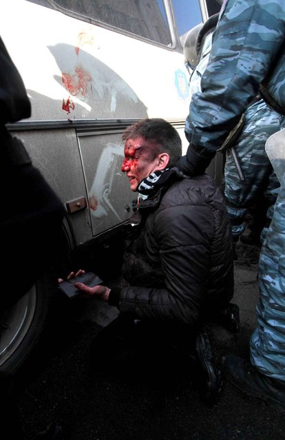 Wounded people after clashes with riot police in central Kiev February 18, 2014. (Photo by Sergey Starostenko/Newscom/SIPA PRESS)