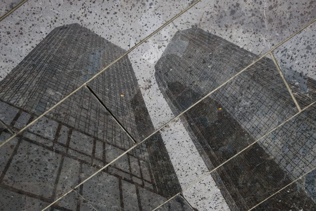 The headquarters of the Deutsche Bank are reflected in the polished floor, in Frankfurt, Germany, April 27, 2015. (Photo by Kai Pfaffenbach/Reuters)
