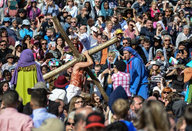 "Actor James Burke-Dunsmore carries a crucifix whilst playing Jesus during The Wintershall's ""The Passion of Jesus"" in front of crowds on Good Friday at Trafalgar Square on March 25, 2016 in London, England. (Photo by Chris Ratcliffe/Getty Images)"