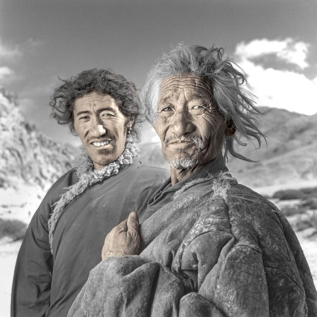 """Pusang and Dundup are father and son. I arrived at their 17,000 ft. nomad camp early in December on a very cold windy day. They had just finished offering prayers prior to sacrificing two yaks for their winters food supply. Everything was so primal. It seemed like an imaginary scene from two hundred years ago on the North American plains"". (Phil Borges)"