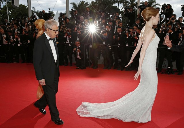 "Director Woody Allen (C), cast members Emma Stone (R) and Parker Posey pose on the red carpet as tey arrive for the screening of the film ""Irrational Man"" out of competition at the 68th Cannes Film Festival in Cannes, southern France, May 15, 2015. (Photo by Benoit Tessier/Reuters)"