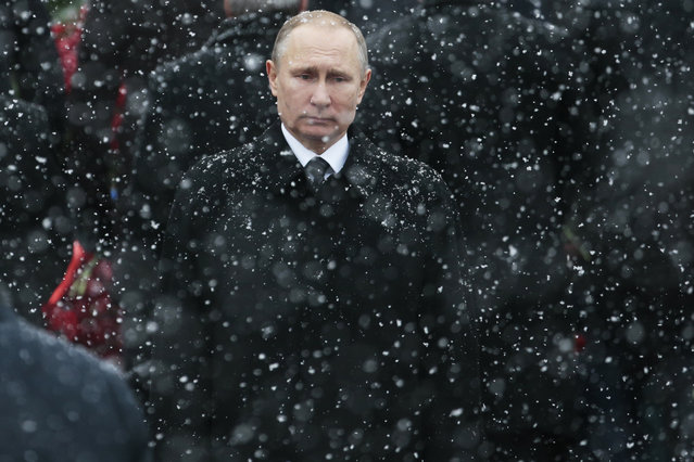 Russian President Vladimir Putin attends a wreath-laying ceremony at the Tomb of the Unknown Soldier in Moscow, Russia, Thursday, February 23, 2017. The Defenders of the Fatherland Day, celebrated in Russia on Feb. 23, honors the nation's military and is a nationwide holiday. (Photo by Ivan Sekretarev/AP Photo)