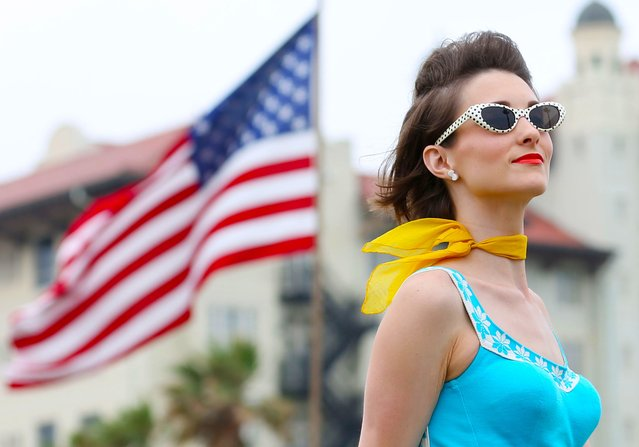 Larena Busceme, of Beaumont, Texas performs during the Bathing Beauties contest at the Galveston Island Beach Revue in Galveston, Texas on Saturday, May 16, 2015. Forty contestants from across the country gathered on the historic shoreline to model vintage swim wear inspired by Galveston's summertime history. (Photo by Jon Shapley/Houston Chronicle via AP Photo)