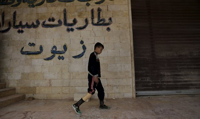 A boy with an amputated leg walks using an artificial limb in the rebel-controlled area of Maaret al-Numan town in Idlib province, Syria March 20, 2016. (Photo by Khalil Ashawi/Reuters)
