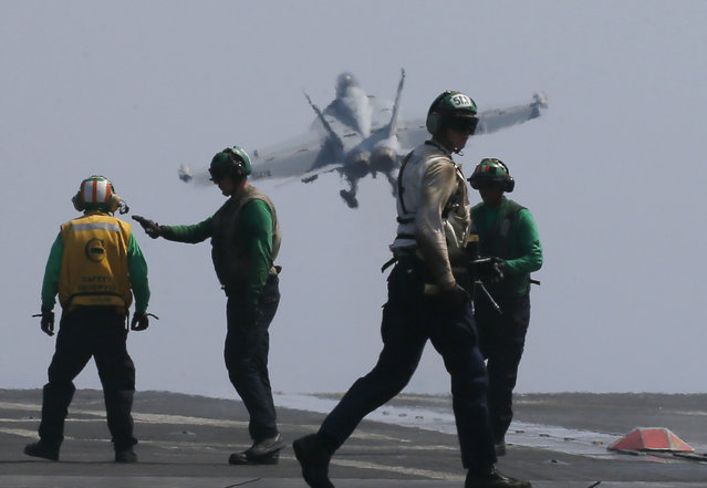 A U.S. Navy F18 fighter jet from the U.S. Navy aircraft carrier USS Carl Vinson (CVN 70) for a patrol off the disputed South China Sea Friday, March 3, 2017. (Photo by Bullit Marquez/AP Photo)
