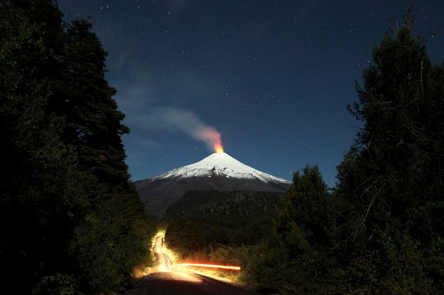 The Villarrica Volcano is seen at night in Chile, April 16, 2016. Villarrica is one of Chile's most active volcanoes. Picture taken with long exposure. Picture taken April 16, 2016. (Photo by Cristobal Saavedra/Reuters)