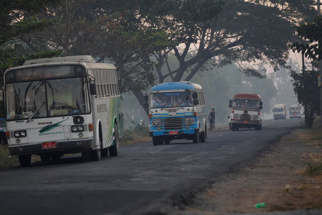 Old buses ride down a road as they carry passengers in Yangon, Myanmar January 16, 2017. (Photo by Soe Zeya Tun/Reuters)