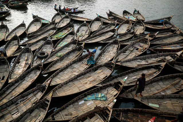 Boats are anchored at the bank of the river Buriganga which are used to carry passengers crossing the river in Dhaka, Bangladesh, June 12, 2019. (Photo by Mohammad Ponir Hossain/Reuters)
