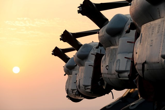 Wings of MV-22 Osprey aircrafts are seen during sunset on the flight deck of USS Boxer (LHD-4) in the Arabian Sea off Oman July 16, 2019. (Photo by Ahmed Jadallah/Reuters)
