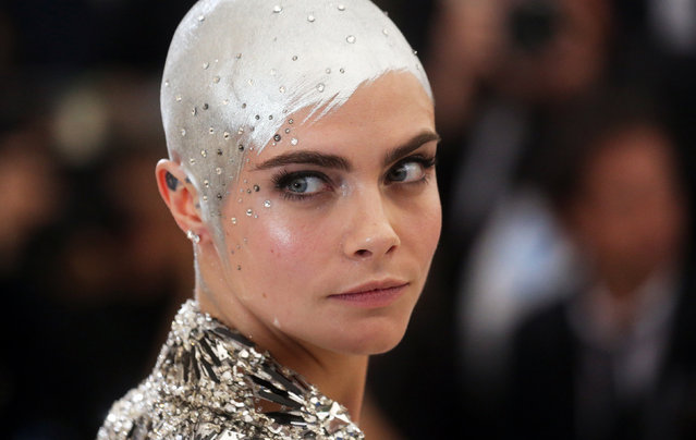 """Cara Delevingne attends """"Rei Kawakubo/Comme des Garcons: Art Of The In-Between"""" Costume Institute Gala – Arrivals at Metropolitan Museum of Art on May 1, 2017 in New York City. (Photo by Carlo Allegri/Reuters)"""