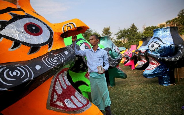 An Indian artist gives final touches to an effigy of mythical demon king Ravana ahead of Hindu festival Dussehra in New Delhi, India, Friday, October 4, 2019. The effigy will be burned during the festival, which celebrates the defeat of demon king Ravana at the hands of Hindu god Rama, marking the triumph of good over evil. (Photo by Altaf Qadri/AP Photo)