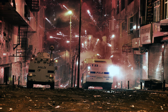 Riot police use water cannon and teargas to disperse people who were protesting the Soma mine disaster that killed 301 miners, in Istanbul, Turkey, late Thursday, March 22, 2014. Two protesters were seriously injured during clashes. (Photo by AP Photo)