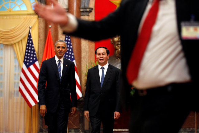 U.S. President Barack Obama and Vietnam's President Tran Dai Quang walk after an arrival ceremony at the presidential palace in Hanoi, Vietnam May 23, 2016. (Photo by Carlos Barria/Reuters)