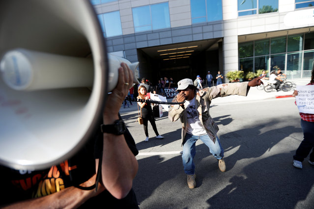 A demonstrator chants in protest against Republican U.S. presidential candidate Donald Trump outside his campaign event in San Jose, California, U.S. June 2, 2016. (Photo by Stephen Lam/Reuters)